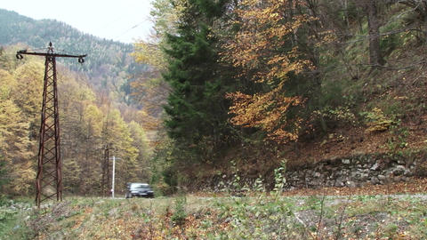 Rally place on a mountain road. A car passing on the road. Rally takes place in  Footage