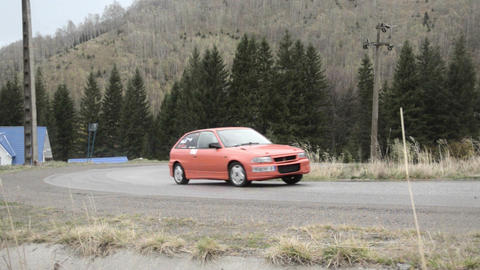 Rally takes place on a mountain road. On the road are dried herbs. In the distan Footage