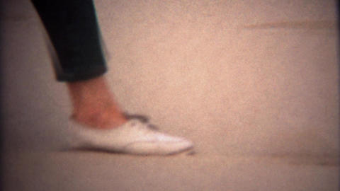 1971: Women shoes closeup walking in deep yellow sand dirt Footage