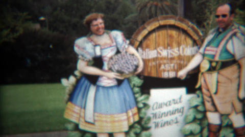 1971: Couple posing at winery in comedy cut out funny business Footage