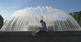 Learns lessons near fountain in the summer park Footage