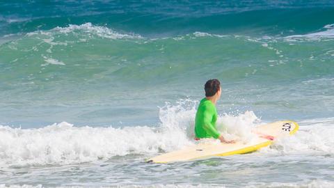 Man Starts Surfing on Board on Large Foamy Wave Footage