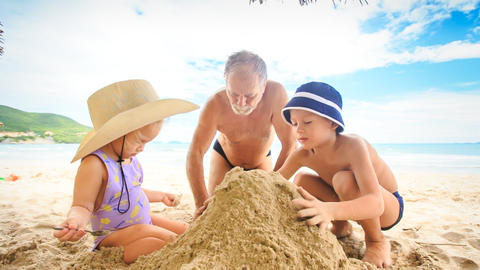 Grandpa Little Girl Boy Squat Make Sand Heap on Beach by Surf Footage