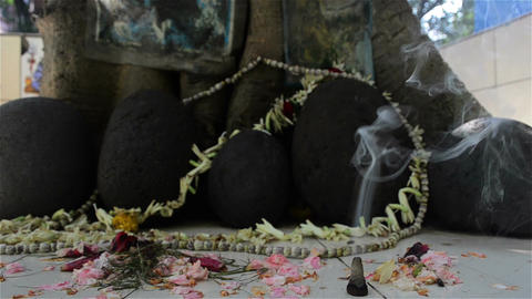 Mid close shot of road side worship of stones/totem Footage