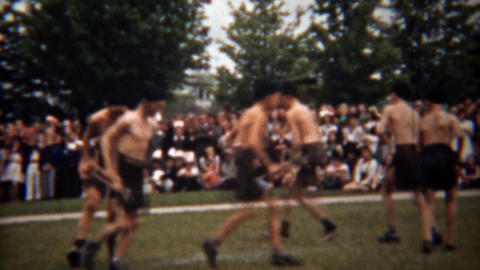 1945: Boy's native american indian tribal dance for outdoor audience Footage