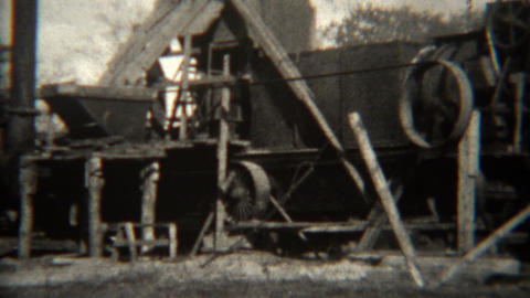 1939: Spinning pulley powered lumber mill factory running full speed Footage