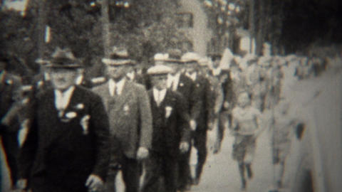 1939: World War 1 veteran parade marching thru small town Footage