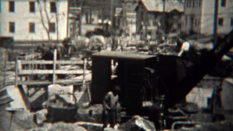 1939: Steam shovel construction crane moving concrete after disaster Footage