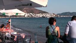 Turkey the Aegean Sea Bodrum 034 city beach with restaurant Footage