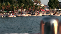 Turkey the Aegean Sea Bodrum 041 boats and palm trees in sunset light Footage