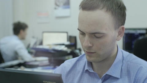 Slow Motion Employee Works out Project on Computer in Plant Footage