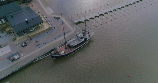 Old ship, Cinema 4k tilt up aerial of a old style ship, in the harbor of the Live Action