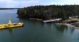 Skåldö cable ferry, Cinema 4k aerial view of a yellow cable ferry, closing in to Live Action