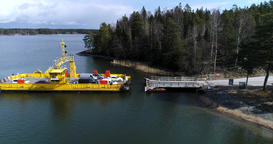Skåldö cable ferry, Cinema 4k aerial view of a yellow cable ferry, docking, at Live Action
