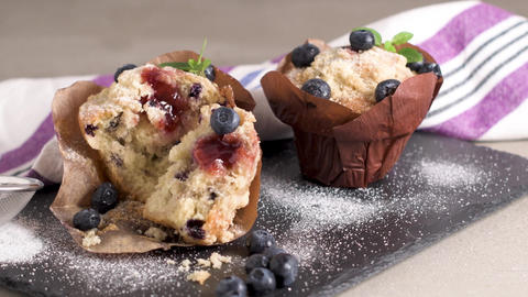 Muffins with red fruits jam fill Footage