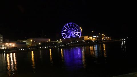 Timelapse of purple colored, Helsinki skywheel, at a dark new years evening Footage