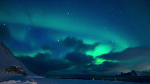 Clouds and Northern Lights in the Night Sky of Lofoten. Time Lapse Live Action