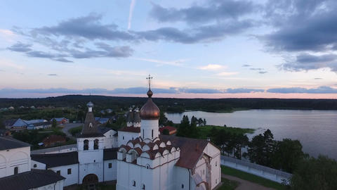 Aerial View of a picturesque ancient monastery on the shore of the lake on the Footage