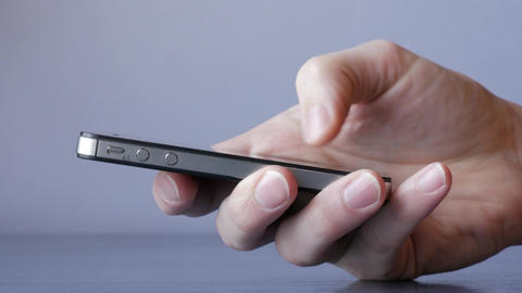 Smartphone texting and browsing internet social network close-up detail hands Live Action