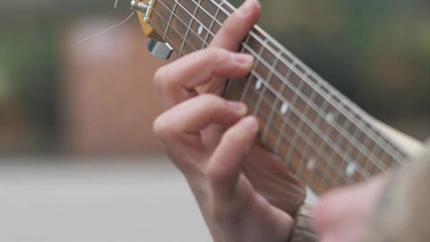 Guitar strings vibrating from plucking, 4K stock footage, man's hands playing 영상물