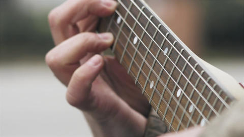 Playing electric guitar cinematic stock footage, close up on man's fingers Live Action