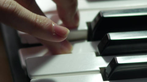 Synthesizer macro fingers playing keys 2160p UHD 4K stock video professional GIF