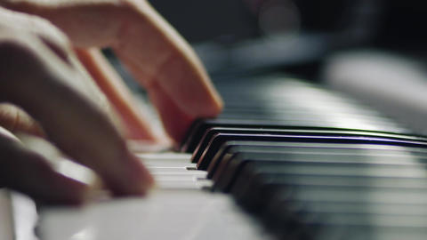 Gentle piano playing by a skilled master professional musician pianist Live Action