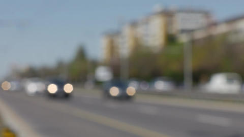 Automobiles driving on a city boulevard out of focus traffic concept footage 4K Footage