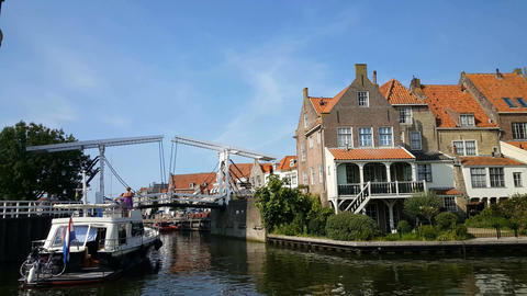 Boat arrives at Enkhuizen harbor and waits for a bridge that opens Footage