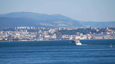 Moving ships against Trieste city harbour and seaport, Italy Footage