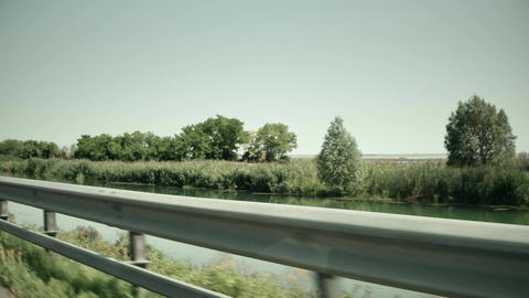 Highway in European wetlands. View from the moving car Footage