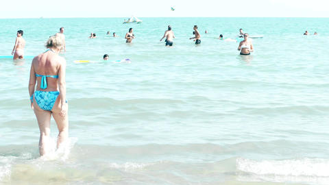 LIDO DI JESOLO, ITALY - AUGUST 8, 2017. People bathing and playing ball on the Footage