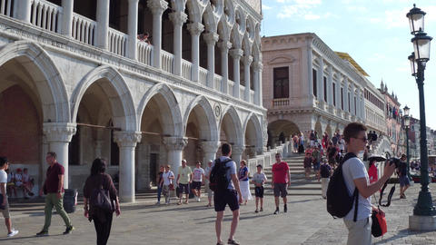 VENICE, ITALY - AUGUST 8, 2017. Tourists near the famous Doge's Palace, one of Footage