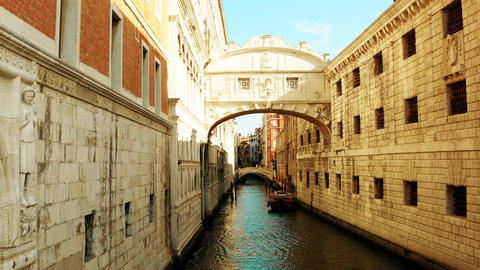 Narrow canal in Venice between old buildings, Italy Footage