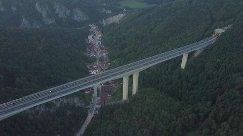 Aerial view of European highway bridge above small town in the evening Footage
