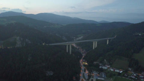 Aerial view of Austrian highway bridge above small town in the evening Footage