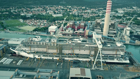 MONFALCONE, ITALY - AUGUST 9, 2017. Aerial view of modern cruise ship MSC Footage