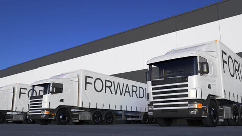 Freight semi truck with FORWARDING caption on the trailer loading or unloading Live Action