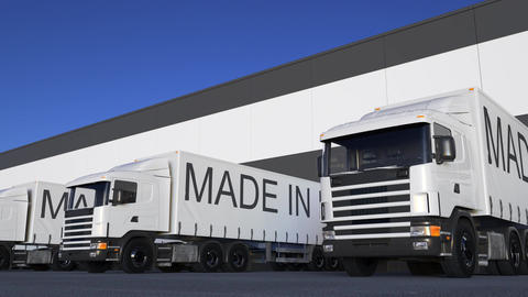 Freight semi trucks with MADE IN EU caption on the trailer loading or unloading Footage