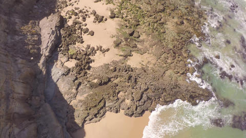Aerial top view of white water waves crashing on rocks - Portugal Footage