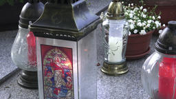 Votive lantern on the tomb. Candle snitch on the tombstone, the feast of the Footage