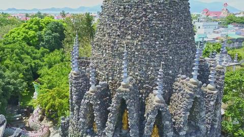 Drone Rotates around Buddhist Temple Tower Steeples Footage