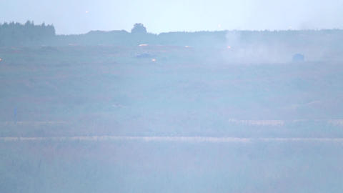 Slow motion video of tracers flying on smoky shooting range Footage