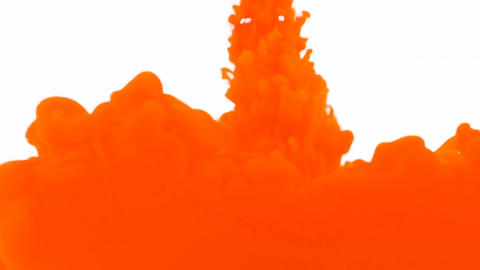 Orange acrylic paint ink dropping and blending with water abstract background Live Action