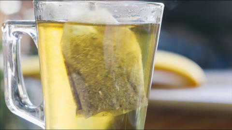 Stirring tea with honey close up 4K stock footage Archivo