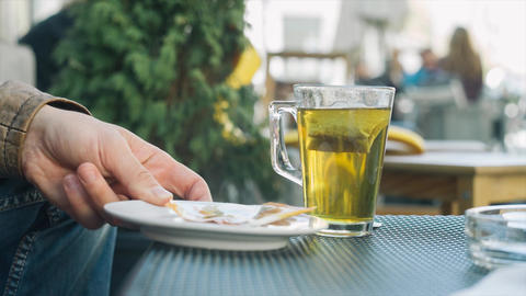 Drinking tea at a cafe, daytime, autumn, yellow tea, honey Footage