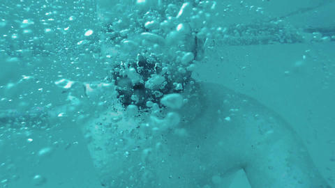 Bubbles underwater slow motion, man's breathing, cinematic shot Live Action