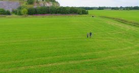 Young couple running in slow motion. Aerial footage. Green fields Footage