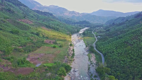 Panoramic View Rocky River near Road between Hilly Landscape Footage