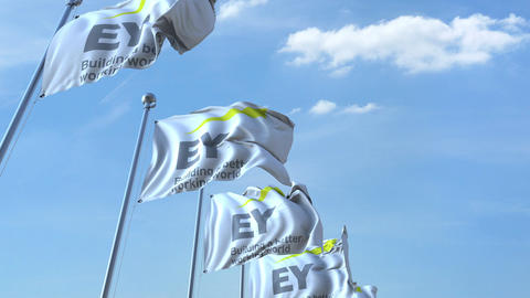 Waving flags with EY logo against sky, seamless loop. 4K editorial animation Footage
